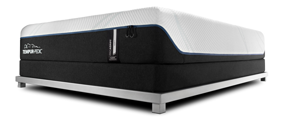 A Tempur-ProAdapt mattress on a foundation and bed frame