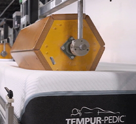 A Tempur-Pedic mattress being tested at a lab